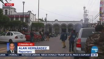 Pobladores de Tultepec se reúnen en el palacio municipal por operativos