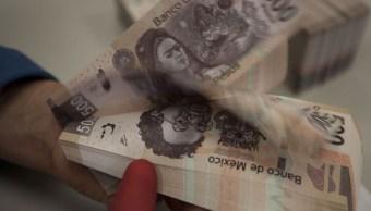 Peso mexicano sube a 18.72 por dólar, con atención a TLCAN