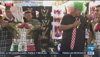 Repor con comerciantes de camisetas en Mercado de Sonora
