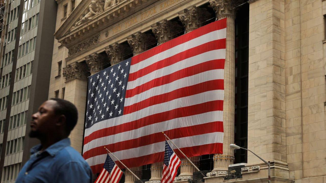 Wall Street gana ante confianza de Fed en el dólar