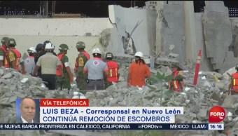 Buscan a trabajador sepultado en centro comercial colapsado