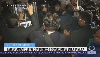 Comerciantes se enfrentan con granaderos en la Basílica
