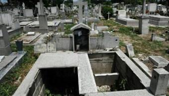 Hallan fosa con 18 cadáveres en Venezuela