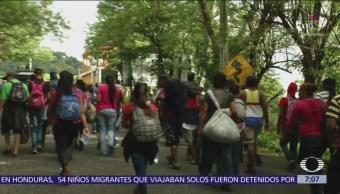 Migrantes de Honduras llegan a la frontera de Guatemala con México