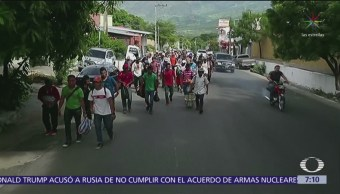 Migrantes forman tercera caravana para cruzar México