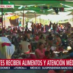 Migrantes reciben alimentos y atención médica