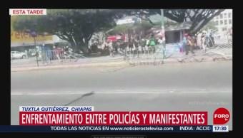 Enfrentamiento entre policías y manifestantes en Tuxtla Gutiérrez, Chiapas