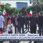 Marchan a favor y en contra de migrantes en Tijuana