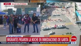Miembros de la caravana migrante regresan a albergue en Tijuana