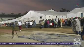 Migrantes se quedarán un día más en albergue de Magdalena Mixhuca