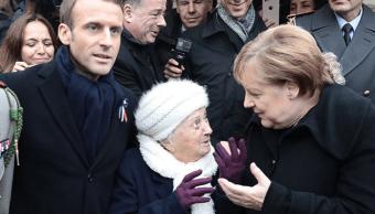 Una anciana confunde a Merkel con la esposa de Macron
