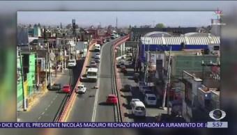 Taxi impacta a motociclista en puente de Ciudad Azteca, Ecatepec