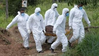 Foto: Rescatistas cargan un cuerpo recuperado después del colapso de una presa de una mina en Minas Gerais, Brasil, del 28 de enero del 2019