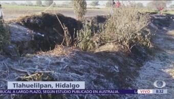 Habitantes de Tlahuelilpan buscan a familiares en zona de explosión