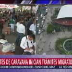 Integrantes de la caravana migrante inician trámites migratorios