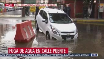 Foto: Cae auto en pequeño socavón en alcaldía Tlalpan