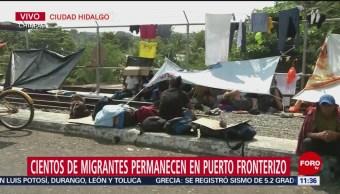 Cientos de migrantes permanecen en puerto fronterizo en Chiapas