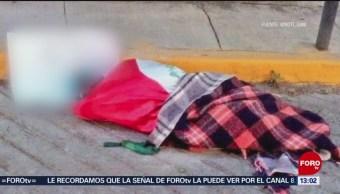 Foto: Encuentran cuerpo envuelto en una bandera en la GAM