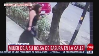Foto: Exhiben a mujer tirando basura en la calle en la CDMX