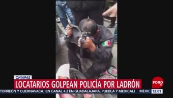 FOTO: Locatarios golpean a policía por ladrón en Chiapas, 2 febrero 2019