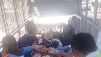 Foto: Rescatan a mujer tras ser arrollada por convoy en Metro Guelatao 8 marzo 2019
