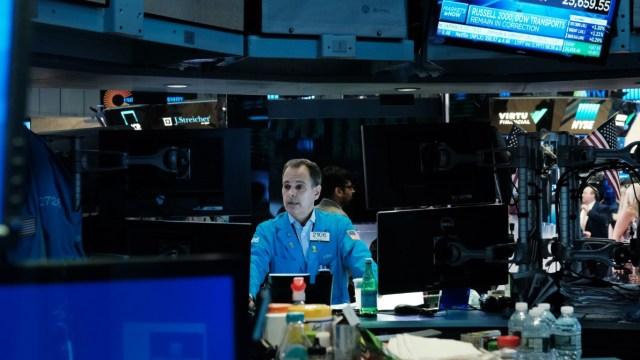 Foto: Los comerciantes trabajan en el piso de la Bolsa de Nueva York (NYSE), mayo 28 de 2019 (Getty Images)
