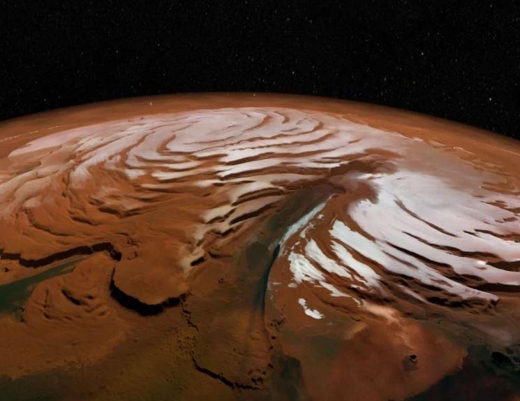 Foto: Las capas se formaron cuando el hielo se acumuló en los polos durante las pasadas eras de hielo marcianas, 22 mayo 2019