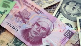 Peso gana frente al dolar tras elminiación aranceles de EU