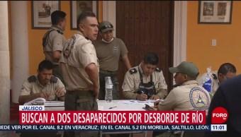 Buscan a dos desaparecidos por desborde de río en Jalisco