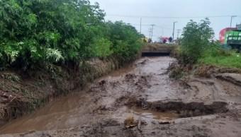 Foto: Desbordamiento de río 'El Jaral' en Mexicaltzingo, 6 de junio 2019. Twitter @CaemEdomex