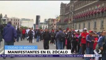 Manifestantes frente a Palacio Nacional, preparan marcha a Cámara de Diputados