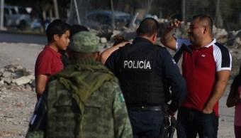 Foto: Elementos de la Guardia Nacional y Policías Estatales vigilan las cercanías del Río Bravo, 27 de junio 2019. EFE