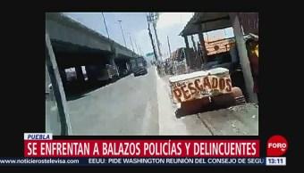 FOTO: Se enfrentan a balazos policías y delincuentes en Huixcolotla, Puebla