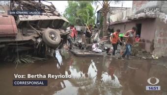 FOTO: Suman tres muertos por desbordamiento de río en Jalisco