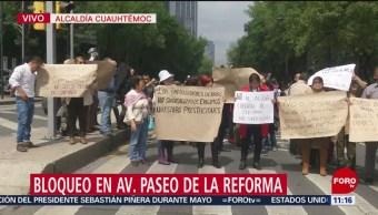 Trabajadores bloquean Reforma e Insurgentes, en CDMX