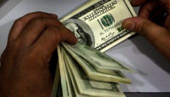 FOTO Dólar abre a la baja, se vende en 19.42 pesos (AP, archivo)
