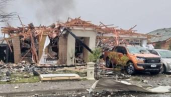 Foto: Explota una casa en el barrio de Northwood, en Christchurch, Nueva Zelanda. El 18 de julio de 2019