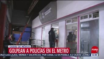 Golpean a policías CDMX durante riña en estación Ciudad Deportiva del Metro