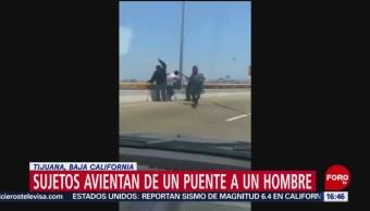 FOTO: Golpean y lanzan a hombre de puente en Tijuana