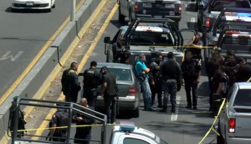 Foto: En el lugar, a bordo de un vehículo en color gris, fueron detenidos dos hombres mientras que otros dos lograron escapar, el 14 de julio de 2019 (Noticieros Televisa)