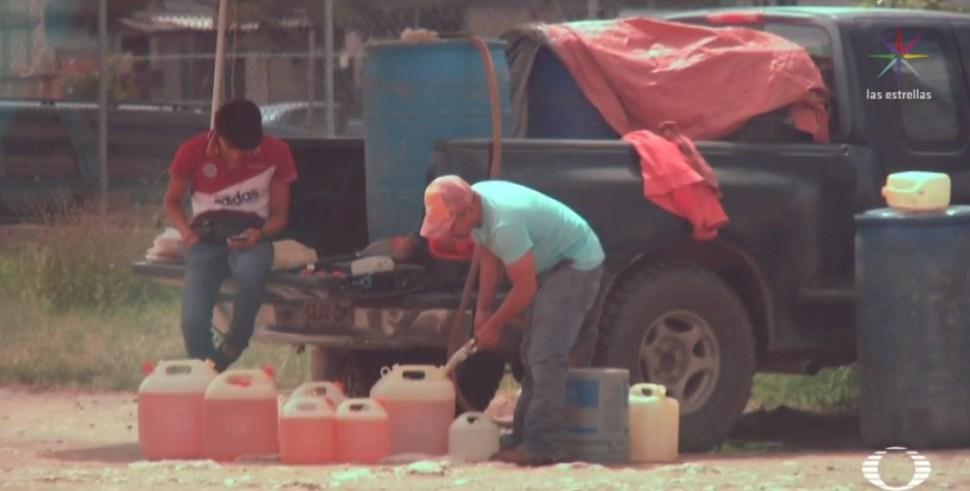Foto Niños despachan venta ilegal de gasolina en Chiapas 1 julio 2019