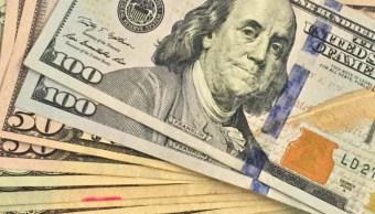 FOTO Dólar sube casi 2 por ciento tras renuncia de Carlos Urzúa (AP, archivo)