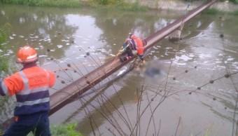 Foto: Rescatan cuerpo de hombre en canal de Puebla, 26 de julio de 2019