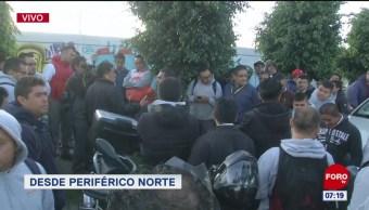 Trabajadores bloquean Periférico Norte; piden que baje el precio del pollo
