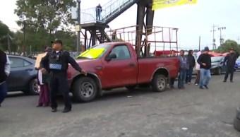 FOTO Bloqueo en la carretera México-Cuernavaca, a la altura de Topilejo, por más seguridad y transporte (Noticieros Televisa)