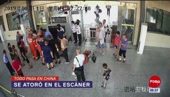 Todo Pasa En China: Se atoró en el escáner