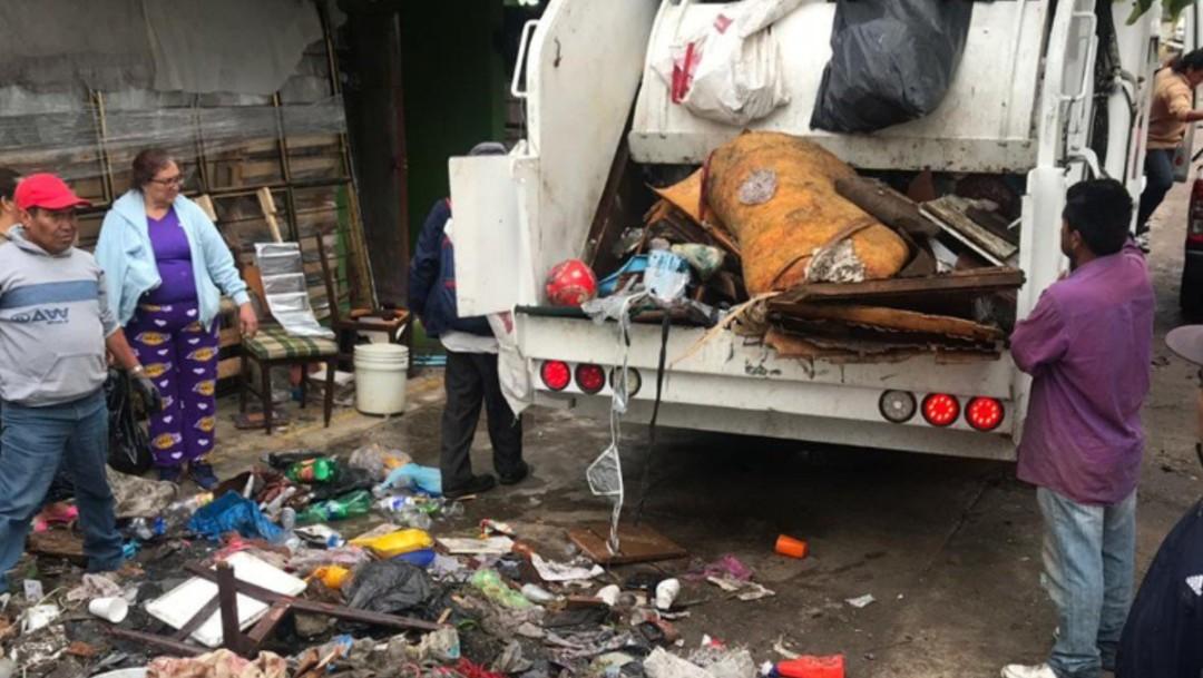 Foto: Realizan labores de limpieza tras inundaciones en Villa Nicolás Romero, 7 de agosto de 2019, Estado de México