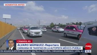 Caravana de taxistas recorre autopista México-Puebla