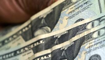 FOTO Dólar se vende hasta en 20.15 pesos (AP, archivo)