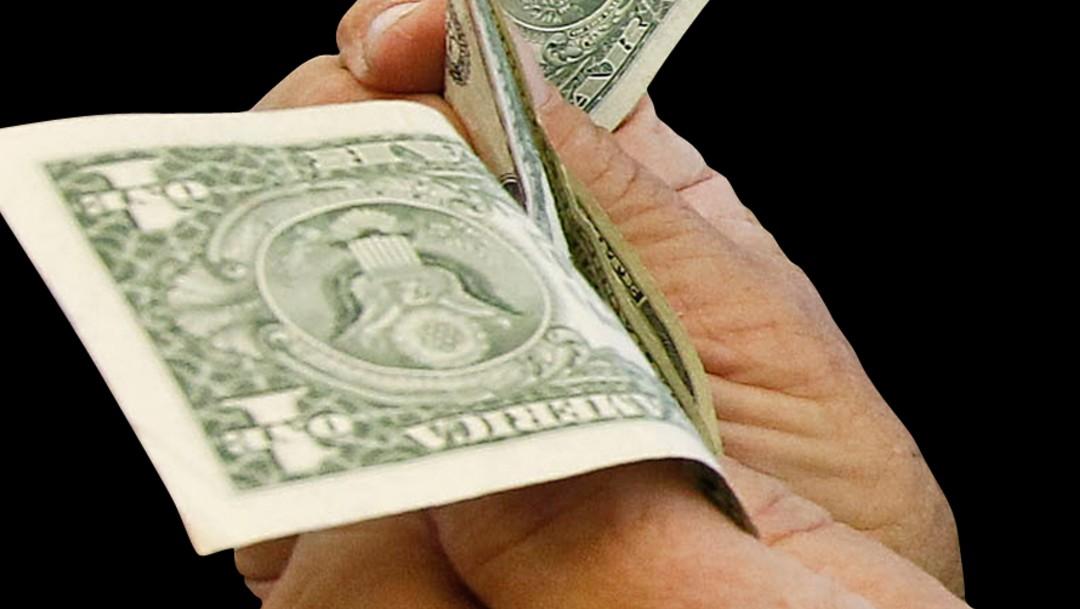 FOTO Dólar abre a la baja, se vende en 19.72 pesos (AP, archivo)